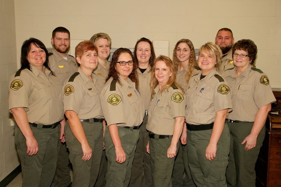 Dispatcher/Jailers standing together in uniform in an office